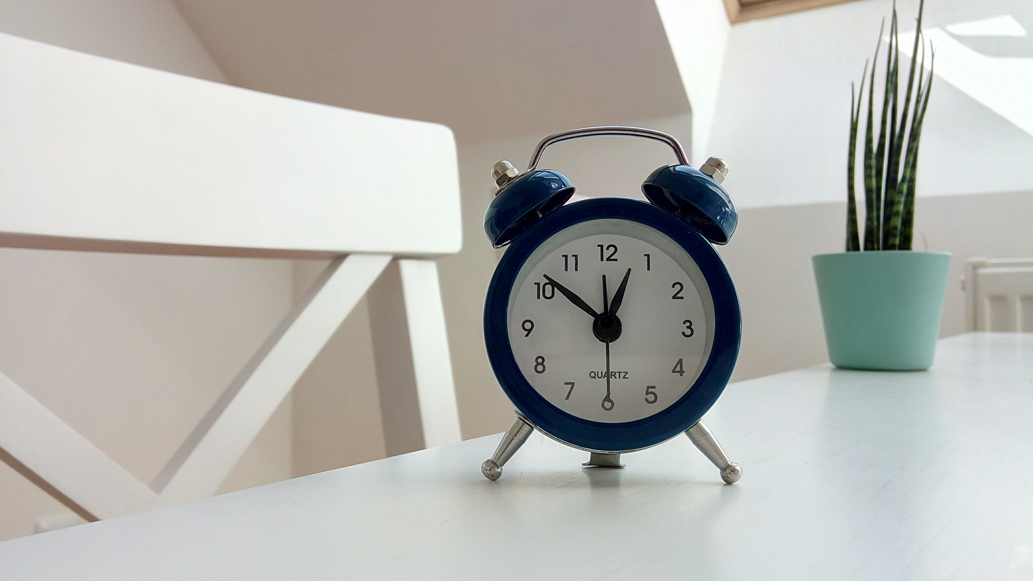 Classic alarm clock on a table